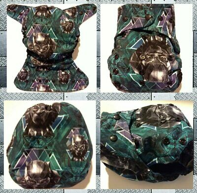 Cloth diaper SassyCloth one size pocket diaper with panther hero cotton print.