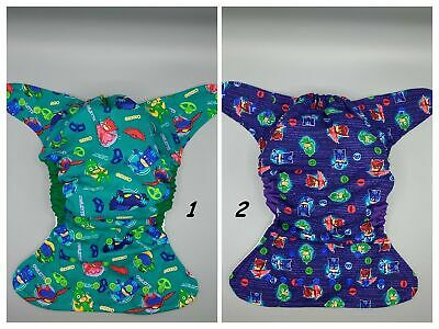 Cloth diaper SassyCloth one size pocket diaper with pajama heroes cotton print.