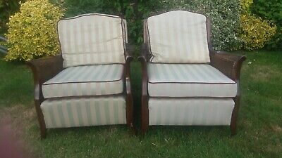 Pair of mahogany Bergere chairs, excellent condition. Living room/conservatory.