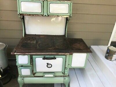 antique cast iron kitchen stove, Montgomery Wards with 6 burners and oven.