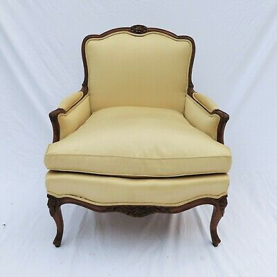 A Louis XV Style Carved Fruitwood and Silk Upholstered Bergere French Chair
