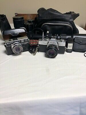Minolta SRT200 and Bell And Howell Autoload 342 Plus Misc Accessories