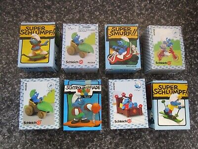Smurfs Lot of 8 Super Smurf in boxes vintage Rare (e)