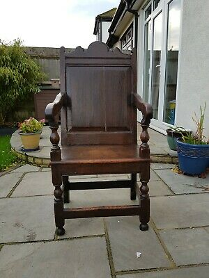solid oak antique furniture A Queen Anne oak panel back chair.