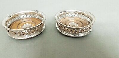 A Matching Pair Of Antique Silver Plated Wine Glass Coasters.pierced patterns.