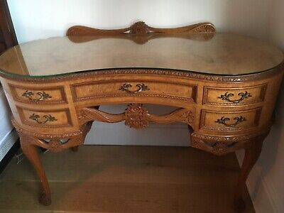 beautifully carved solid wood table in excellent condition