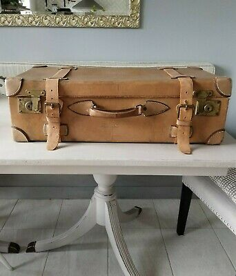Beautiful antique beige large leather suitcase with closing straps