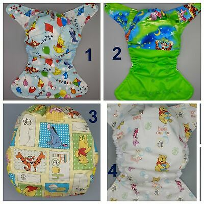 SassyCloth one size pocket cloth diaper with Winnie the Pooh cotton print.