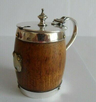 Vintage mustard pot in wood and silver coloured metal with a vacant cartouche.