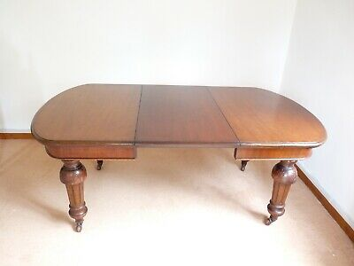 Large Victorian mahogany wind out dining table & handle with one extra leaf