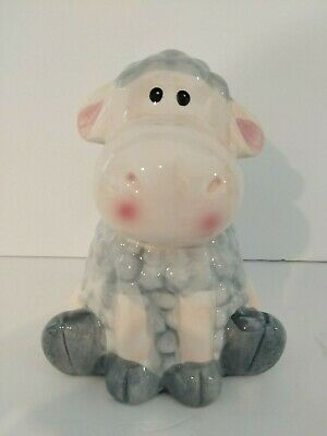 Cute pastel baby blue sitting sheep coin bank for nursery decor