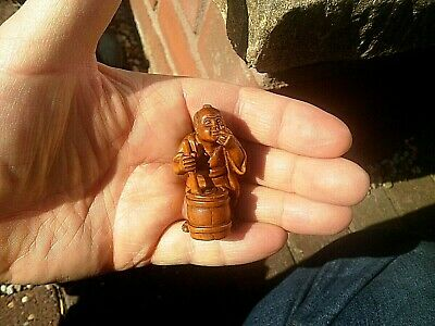 Hand Carved wood netsuke old man stirs barrel figure boxwood netsky netski