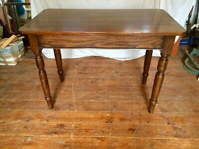 An Antique Mahogany and Elm Kitchen table.
