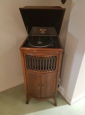 Antique Cabinet with Electric turntable unit in it