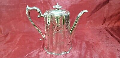 An Antique Georgian Style Silver Plated Tea Pot With Engraved Patterns.