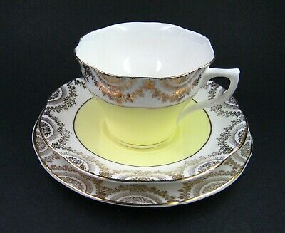 Vintage Springfield Pottery Porcelain Yellow and Gold Teacup Trio
