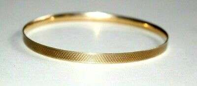 A STUNNING ANTIQUE ART DECO 9CT BRONZE CORE LAGARMIC SLAVE BANGLE. CIRCA 1920's
