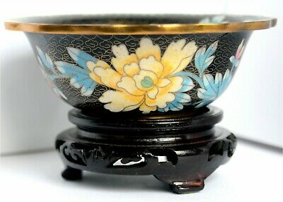 A late Victorian or early 20th Century Chinese cloisonné enamel bowl on a black