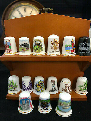 COLLECTORS: Collection of 15 Thimbles with display stand $1 start