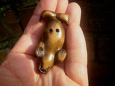 Hand Carved wood netsuke Sea lion or walrus laying down figure boxwood netsky