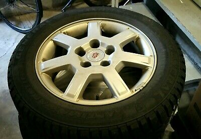 03-07 cadillac rims with snow tires