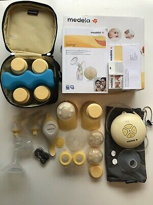 Medela Swing electric breast pump with Calma Bottles and lots of other bits