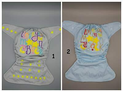 "SassyCloth one size pocket cloth diaper with ""love you to the moon"" embroidery."