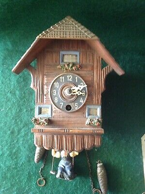 Vintage Small chalet wall clock for spares or repair. Oscillation spring.