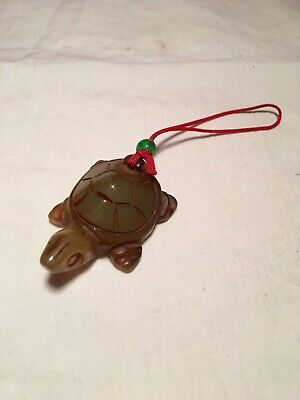Small carved jade turtle pendant