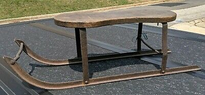 Antique Primative cast iron and wood Sled..
