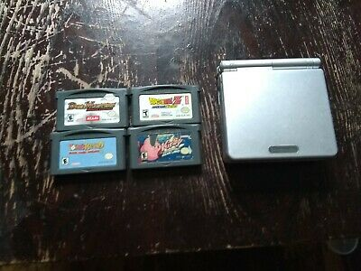 Nintendo Game Boy Advance SP Silver AGS-001 W/ 4 games. Tested and authentic....