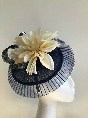 Navy crinoline and sinamay fascinator with loops and cream flower!