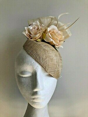 Cream air hostess fascinator with loops, flowers and feathers!