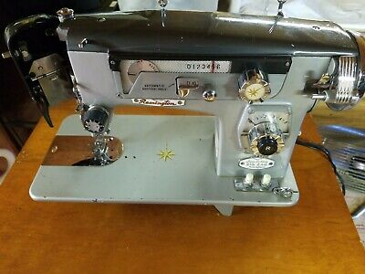Remington Super Deluxe Zigzag Sewing Machine-For parts or repair- light turns on