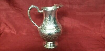 An Antique Silver Plated Water Jug With Beautiful Engraved Patterns.