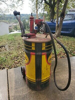 vintage pennzoil drum complete with pump and dollie.. almost mint!