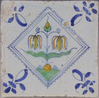 Nice Dutch Delft polychrome tile, tulips in blue diamond, 17th. century.