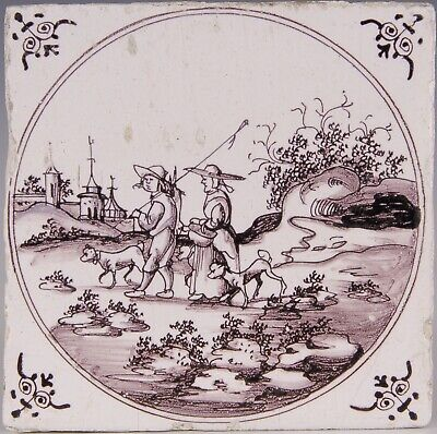 Nice Dutch Delft manganese tile, figures and dogs in landscape, 18th. century.