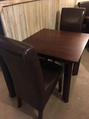 Table and 4 Brown Faux Leather Dining Chairs