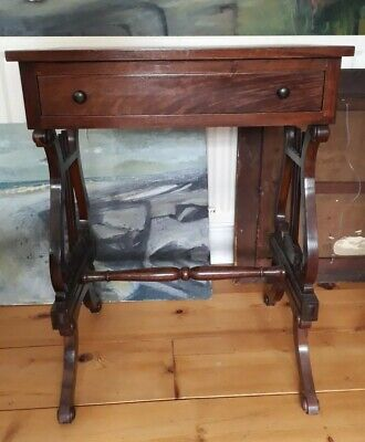 Mahogany small table with useful drawer. Regency style with ornate lyre legs.