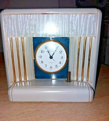 Art Deco mantle clock in the style of a fireplace