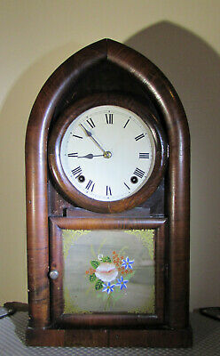 Antique 8 day American chiming Mantel clock by E.N Welch