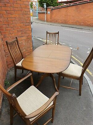 Ercol Solid Extending Dining Table With Two Chairs And Two Carvers