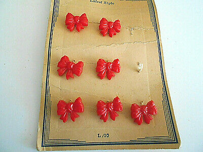 """7 vintage red plastic small bow buttons on card self shank 5/8"""" by 1/2"""""""