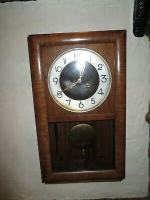 Old 14 Day Wall Clock  in working order except for chime
