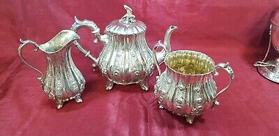 An Antique Victorian Silver Plated Tea Set.respoused Patterns.eagle Finial.