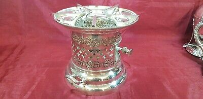 An Antique Victorian Silver Plated Stove Burner with respoused patterns.rare.