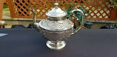 An Antique Silver Plated Tea Pot With Floral & fish Respoused Patterns.g.wish.