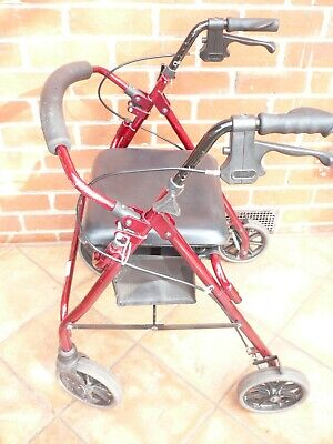 walking rolling frame with seat and shopping bag under seat good condition