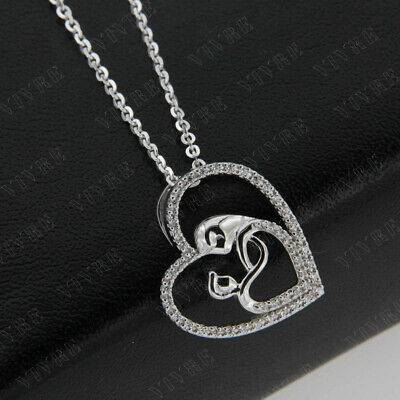 0.20 Ct Round Cut Simulated Diamond Cross with Hanging Heart Necklace Real 925 Sterling Silver